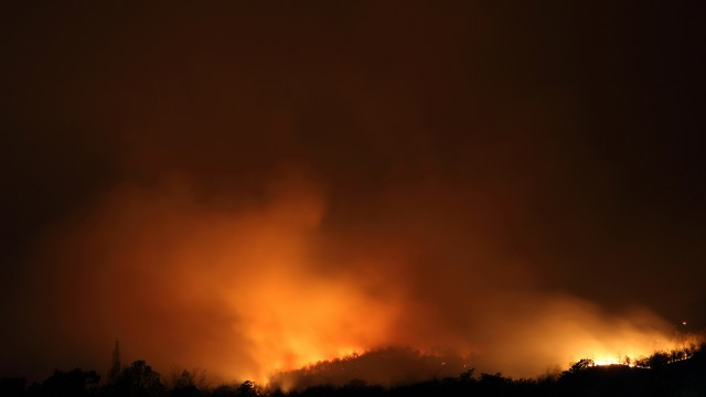 California wildfires burn at least 116,000 acres; 1 woman found dead