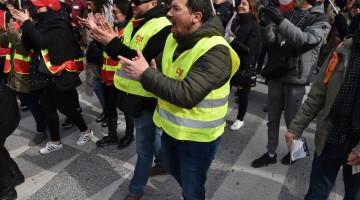 French workers strike over proposed state labor reforms, interrupting rail and flight service
