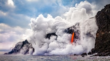 Hawaiian volcanic lava enters ocean creating hazardous gas